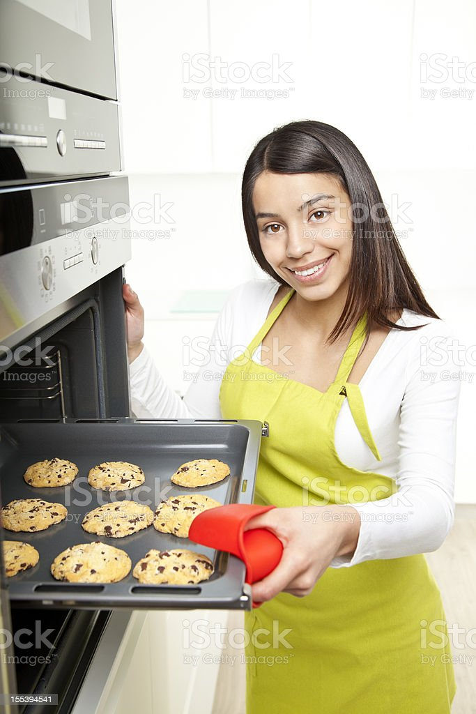 Young woman baking cookies at home royalty-free stock photo