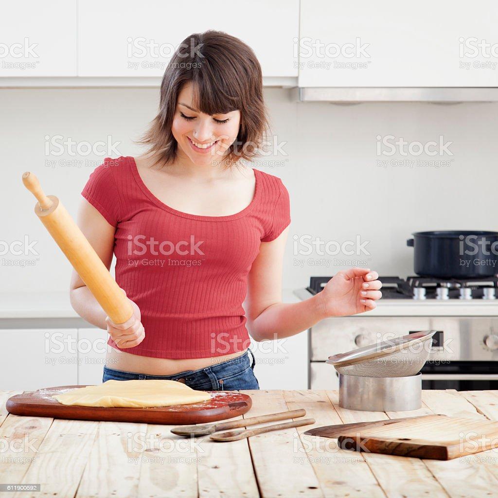 Young woman baking stock photo