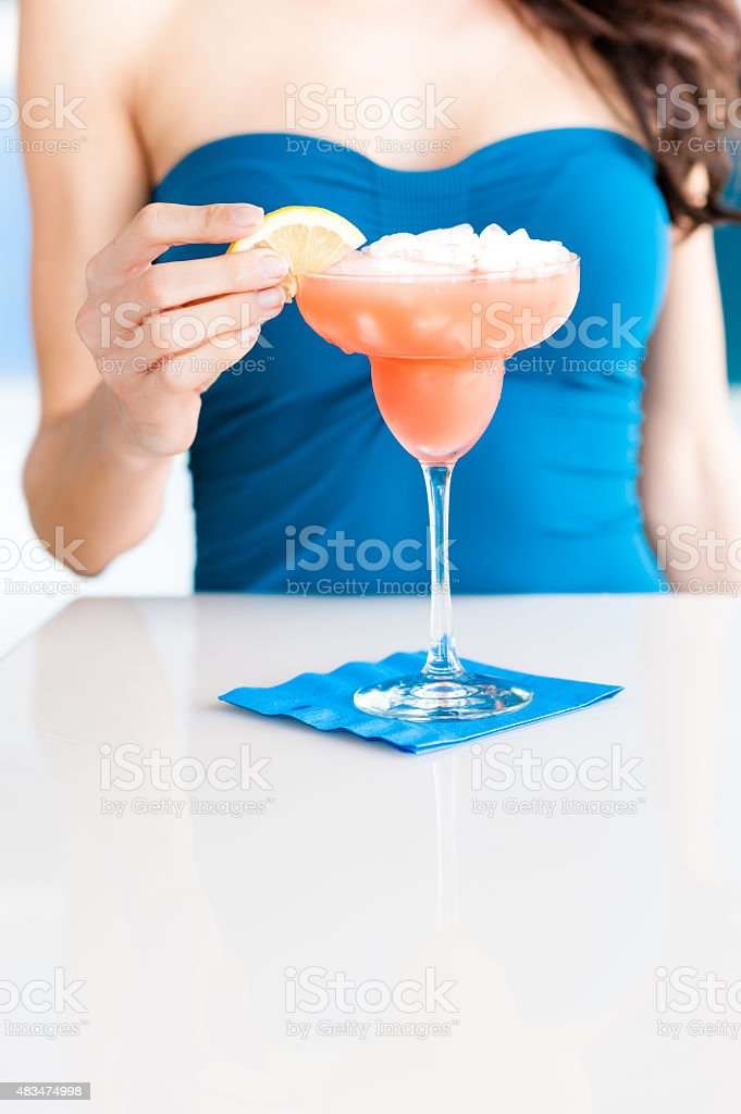 Young Woman Bartender Pouring Margaritas stock photo