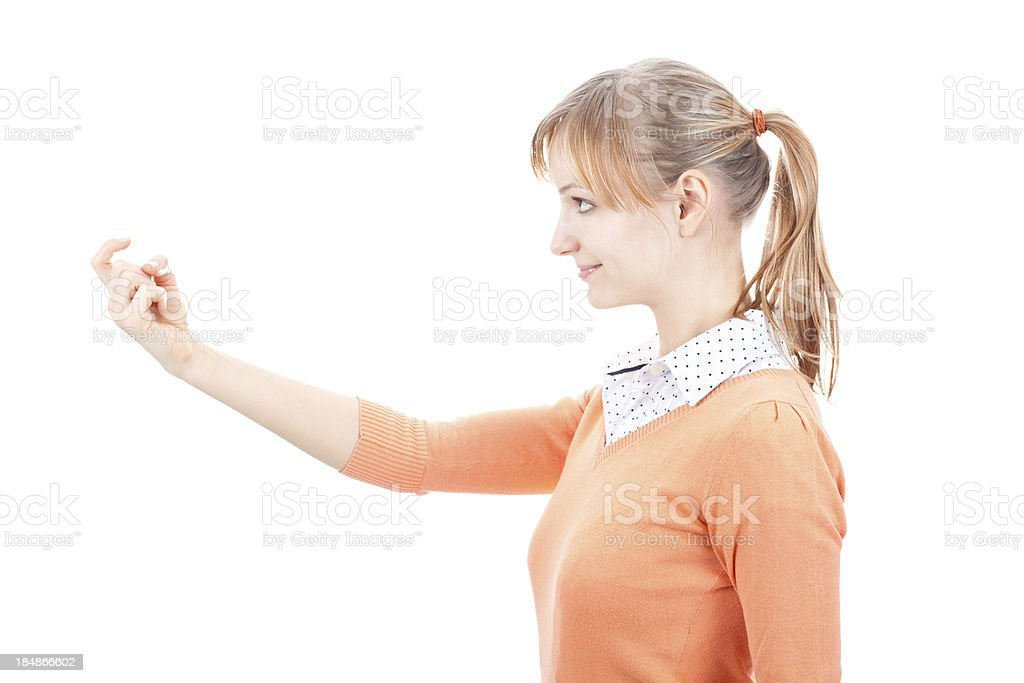 Young woman beckonging with index finger royalty-free stock photo