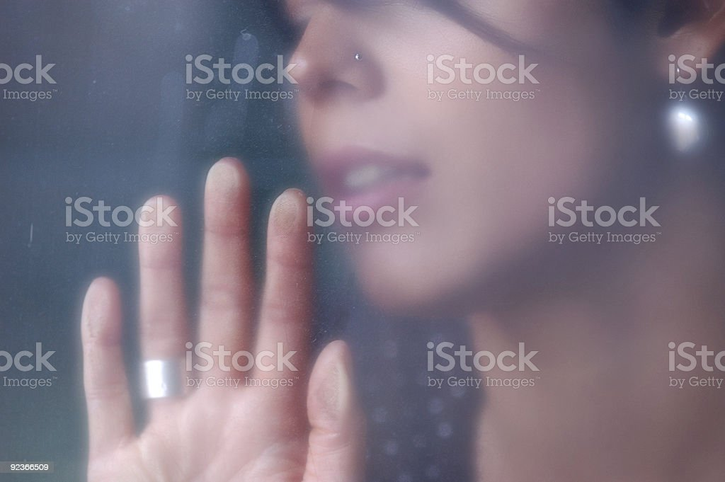 Young woman behind a foggy window royalty-free stock photo