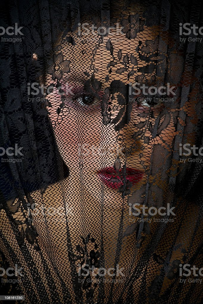Young Woman Behind Lace royalty-free stock photo