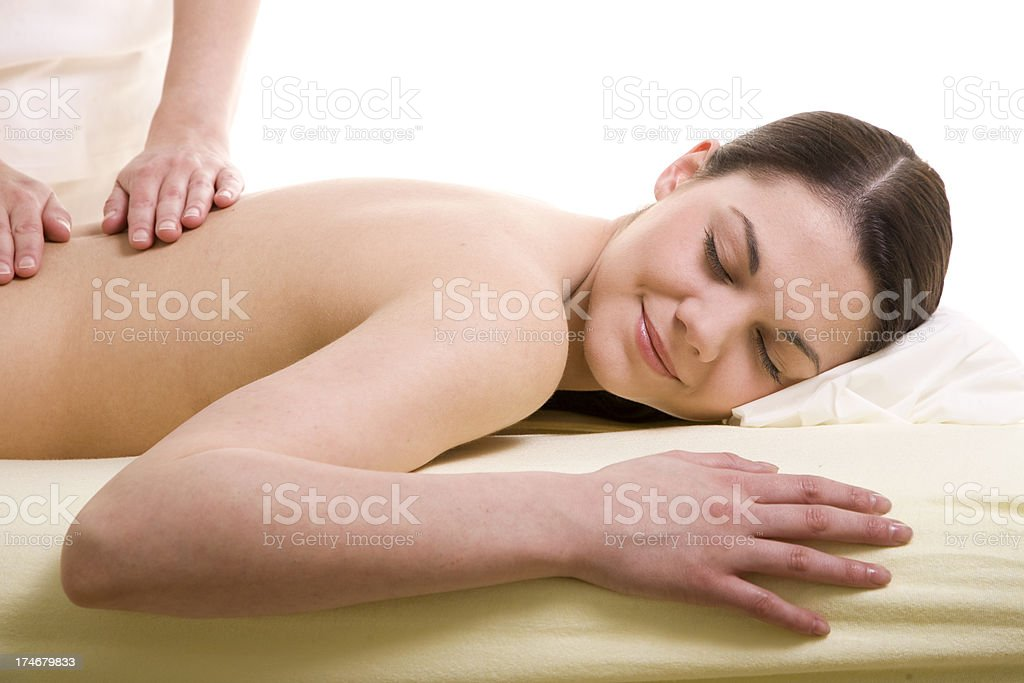 Young woman being massaged royalty-free stock photo