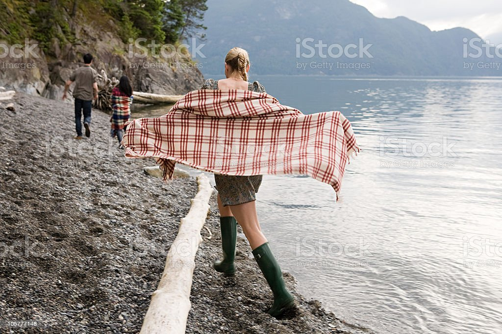 Young woman beside lake with checked shawl royalty-free stock photo