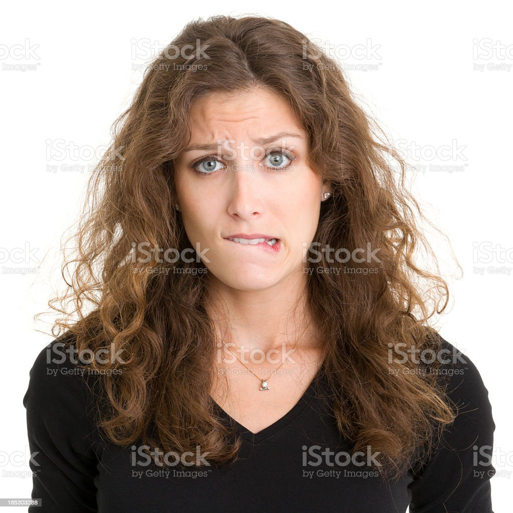 Young Woman Biting Lip stock photo
