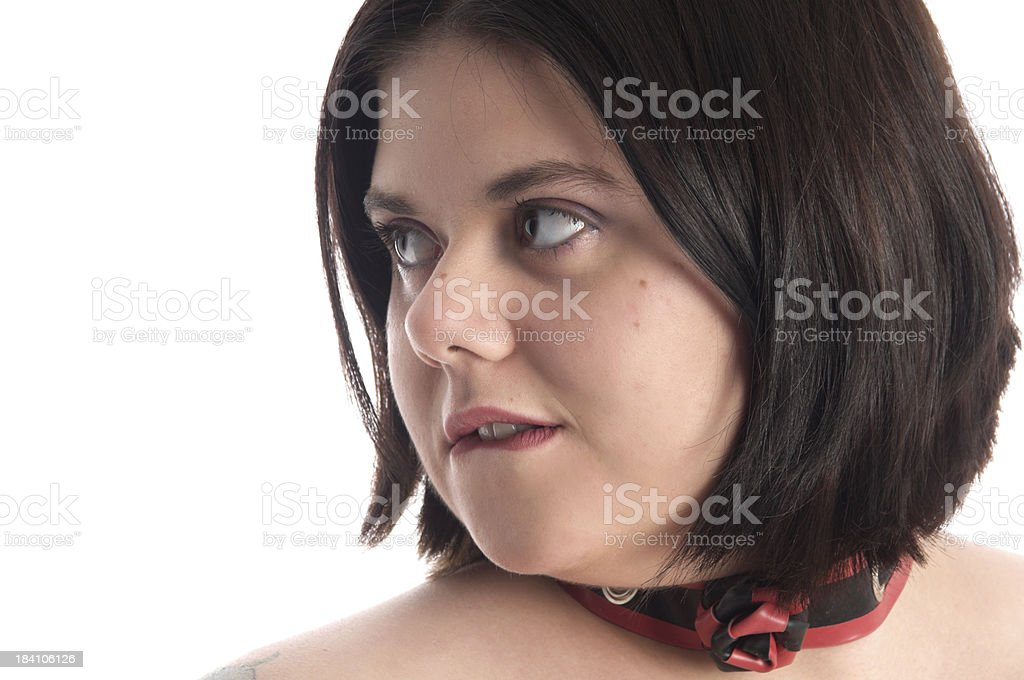 Young woman biting lip, semi-profile royalty-free stock photo