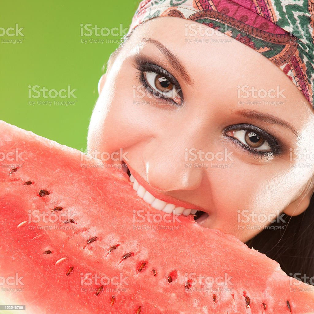 young woman biting red watermelon royalty-free stock photo
