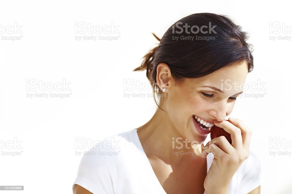 Young woman bitting an apple royalty-free stock photo