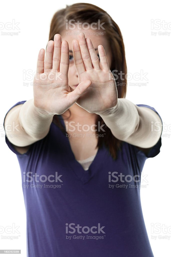 Young Woman Blocking Face With Hands royalty-free stock photo