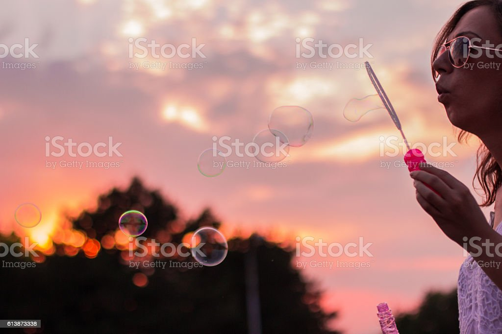 Young woman blowing bubbles royalty-free stock photo