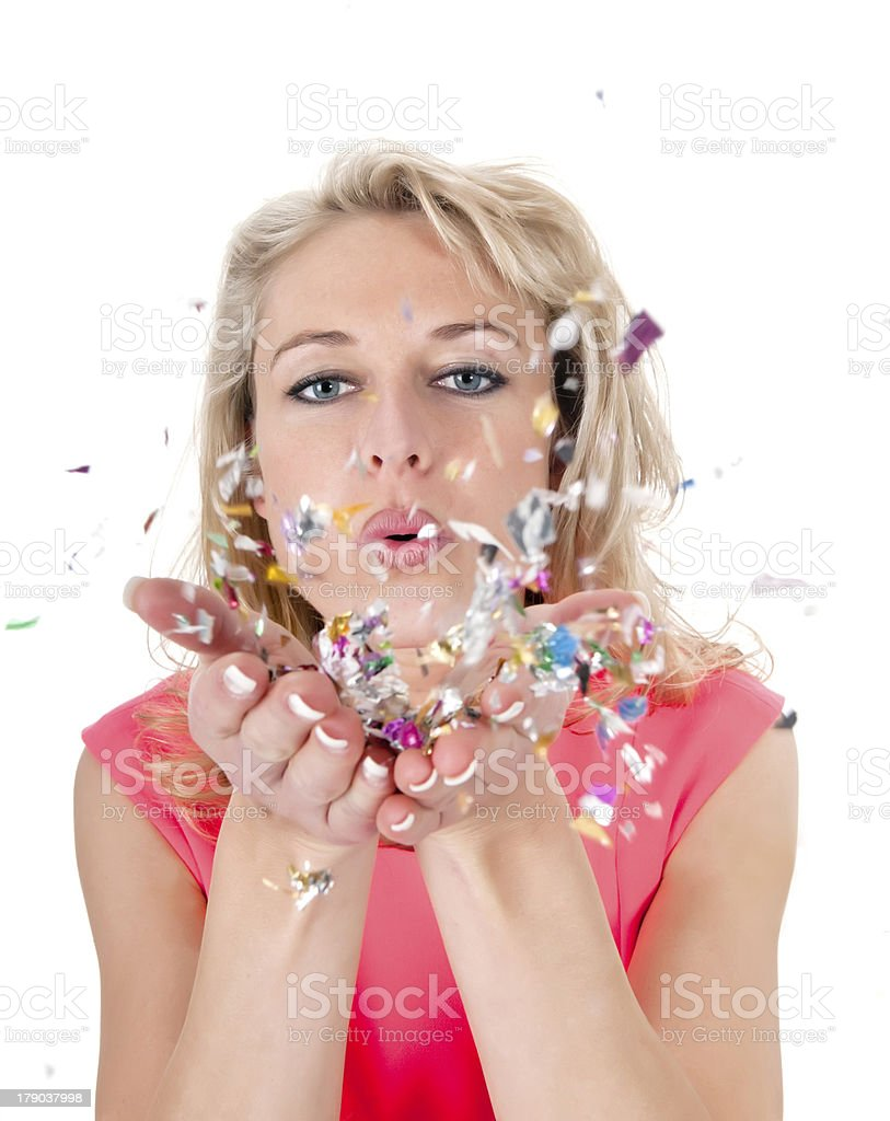 young woman blowing confetti stock photo