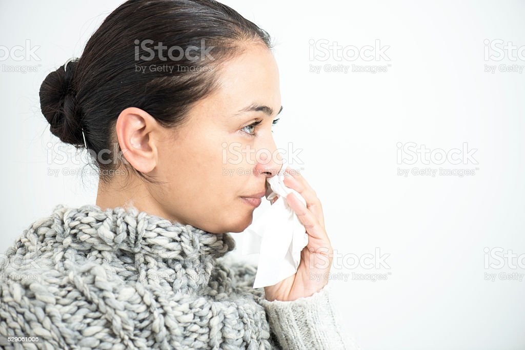 Young Woman Blowing Her Nose stock photo