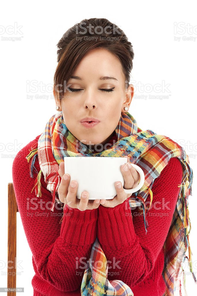 Young Woman Blowing on Hot Coffee royalty-free stock photo