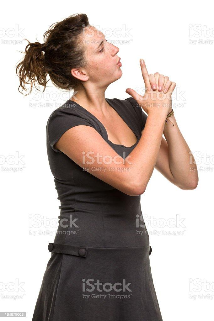 Young Woman Blows Finger Gun stock photo