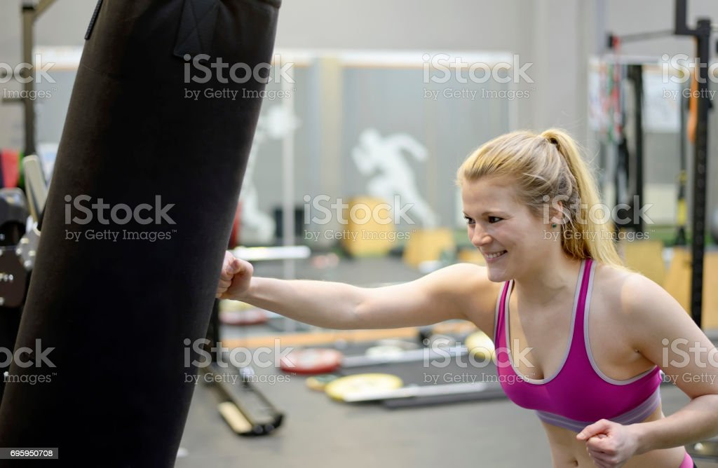 young woman boxing stock photo