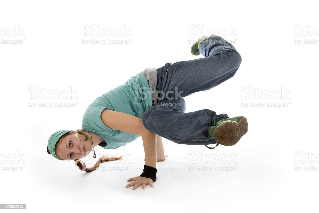 Young woman breakdancing, performing wrist watch move stock photo