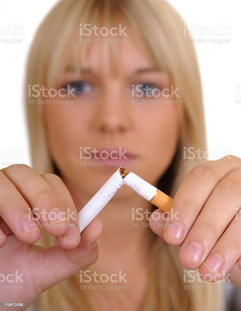 young woman breaks a cigarette royalty-free stock photo