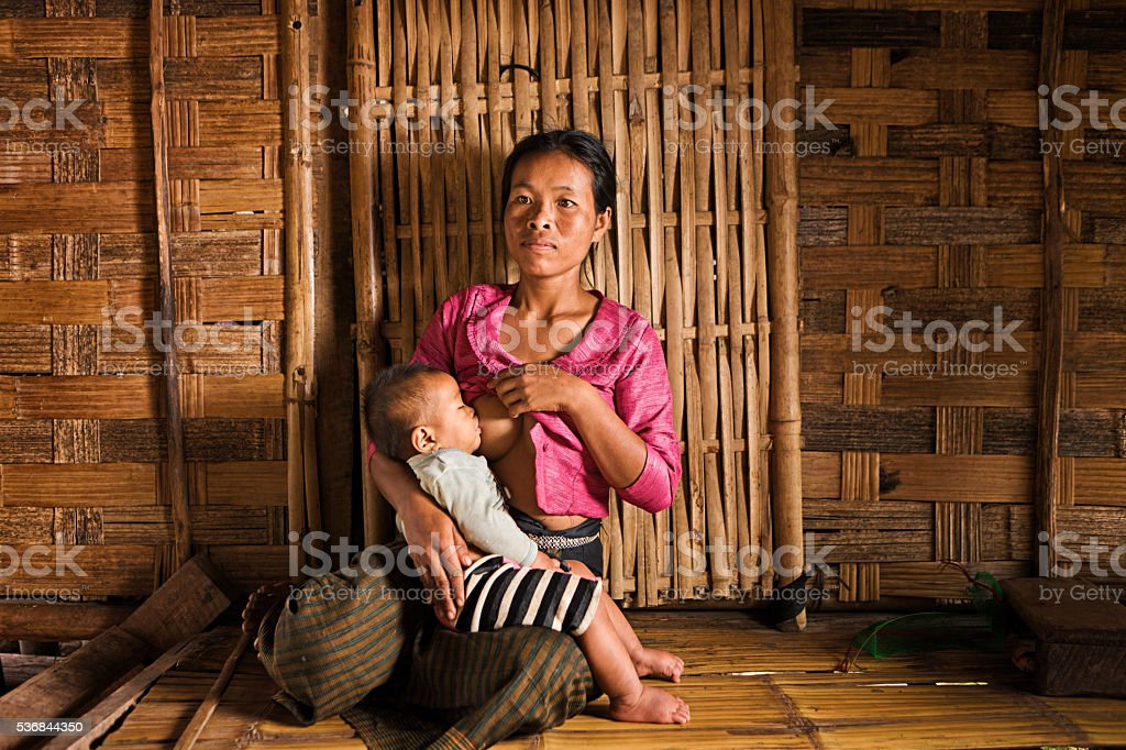 Young woman breastfeeding her baby near Luang Namtha, Laos stock photo