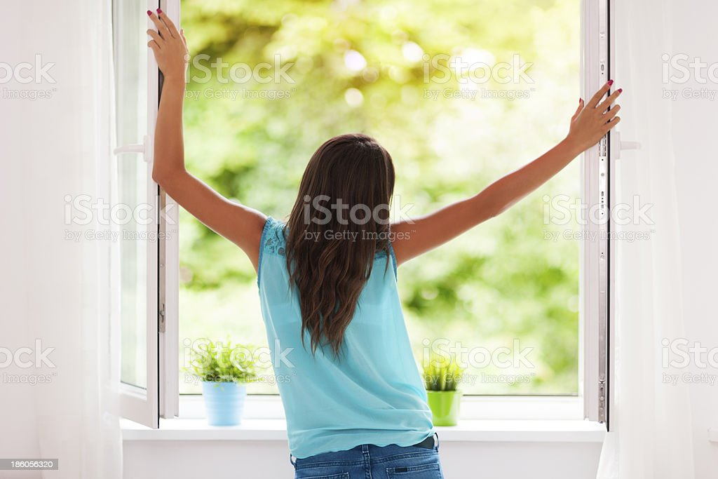 Young woman breathing fresh air during the summer stock photo
