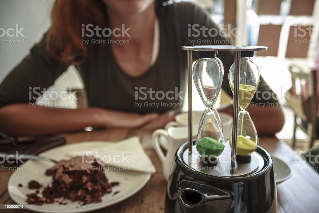 Young woman brewing tea in cafe royalty-free stock photo