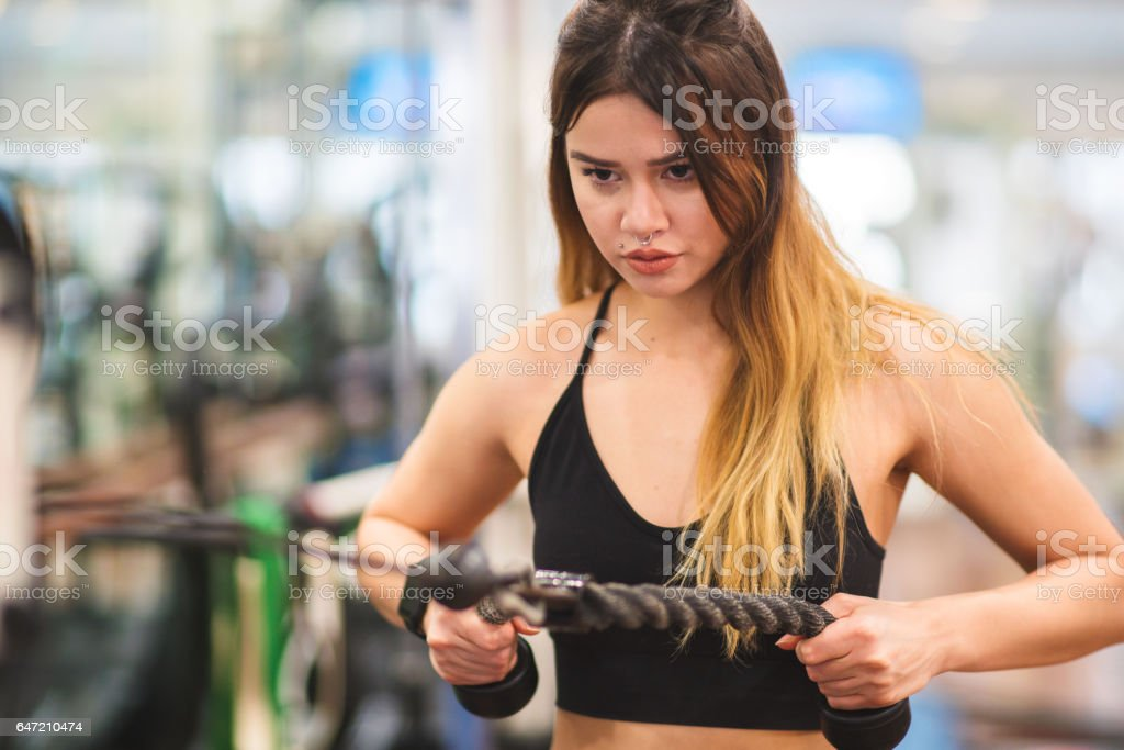 Young woman building her arm muscles stock photo