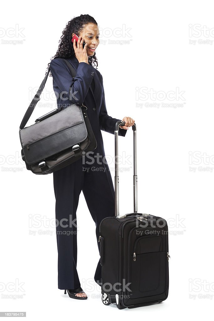 Young Woman Business Traveler with Carry-on Luggage, Talking on Phone stock photo