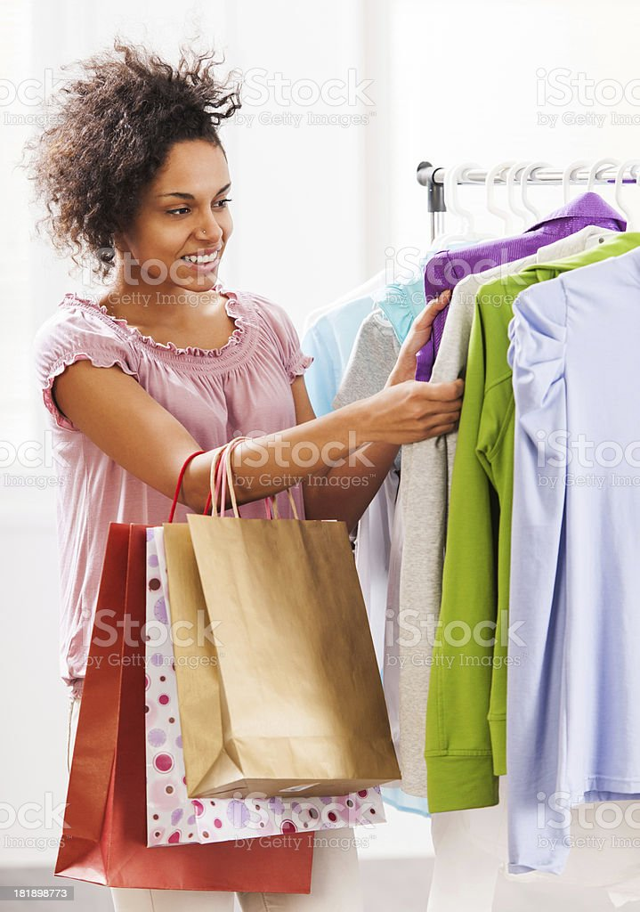 Young woman buying clothes in a boutique. royalty-free stock photo