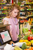 Young woman buying food at the grocery