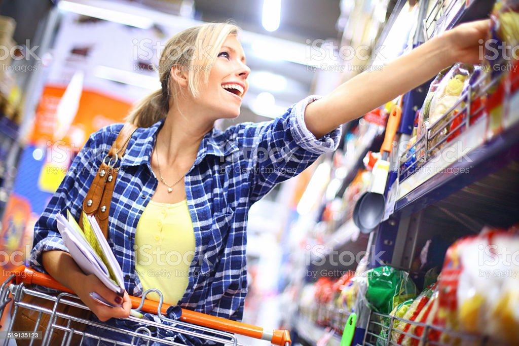Young woman buying food. stock photo