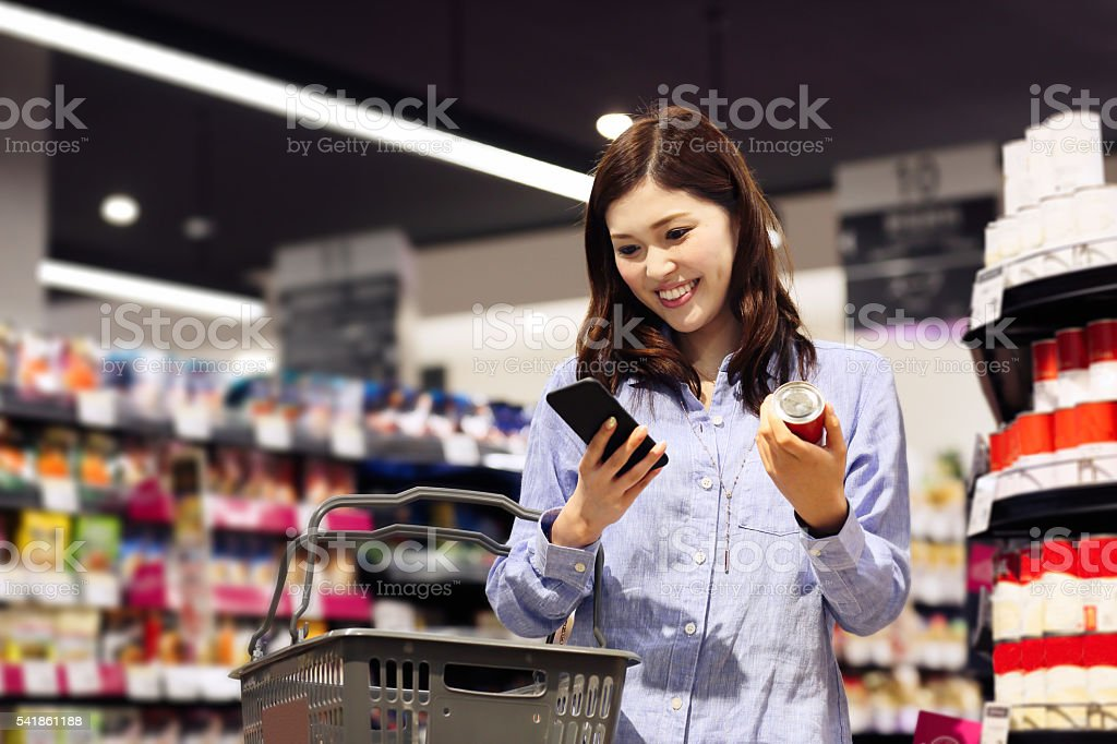 Young woman buying grocery in supermarket stock photo