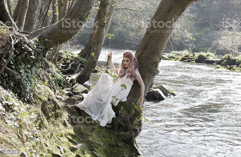 Young woman by river royalty-free stock photo