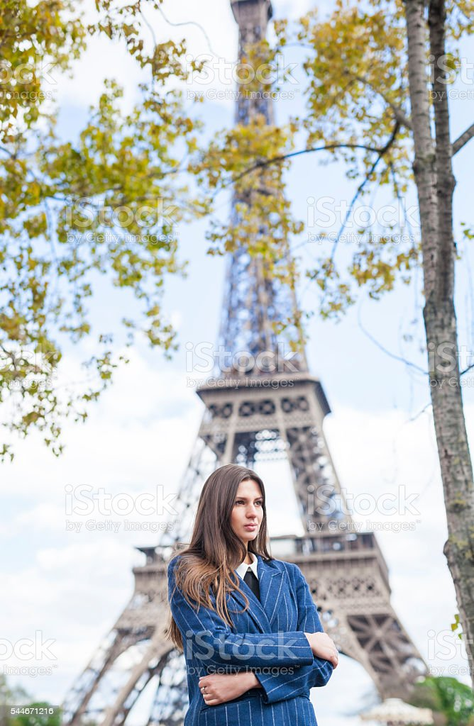 Young Woman By The Eiffel Tower stock photo