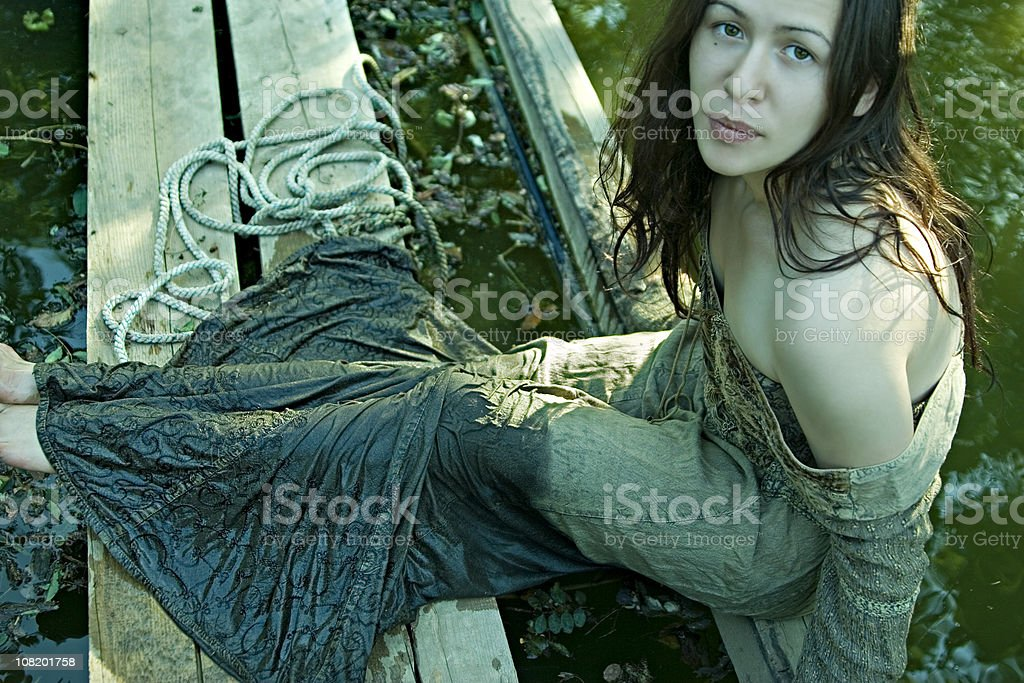 Young woman by the pond stock photo