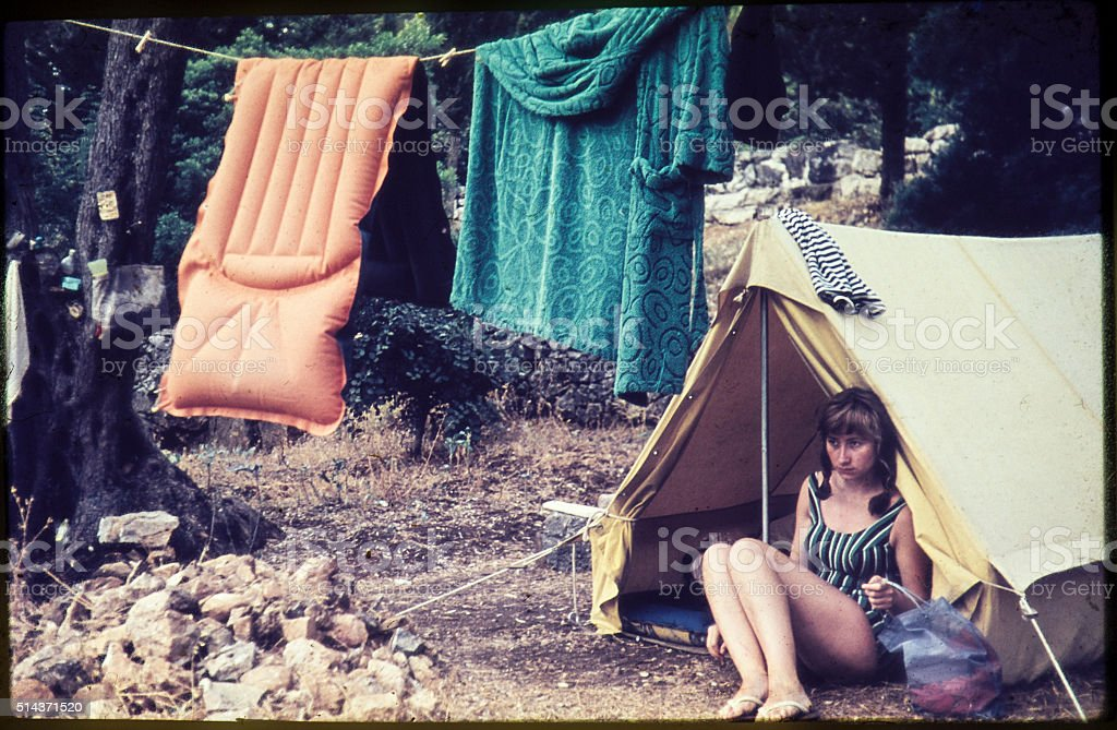 Young woman camping in the 1960s. stock photo