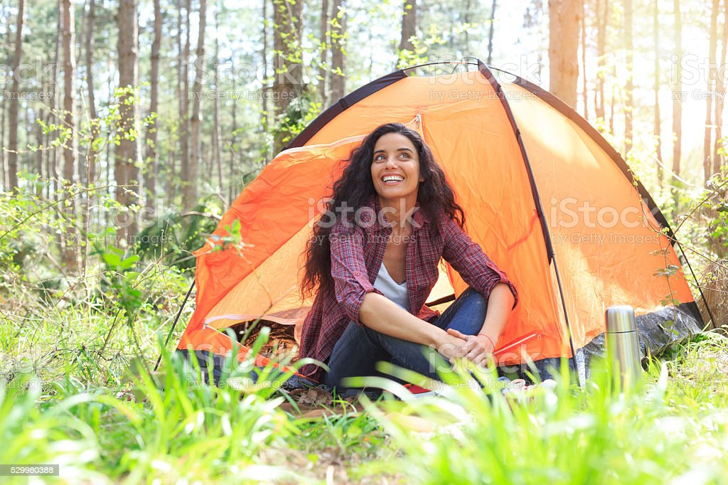 Young woman camping in the forest stock photo