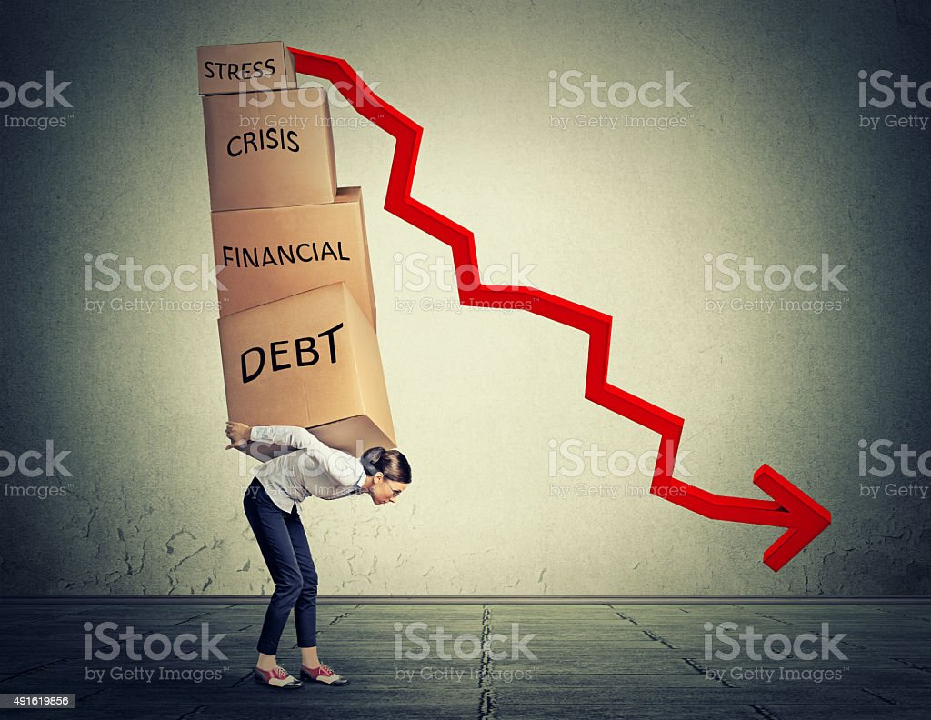 Young woman carrying heavy boxes with financial debt stock photo