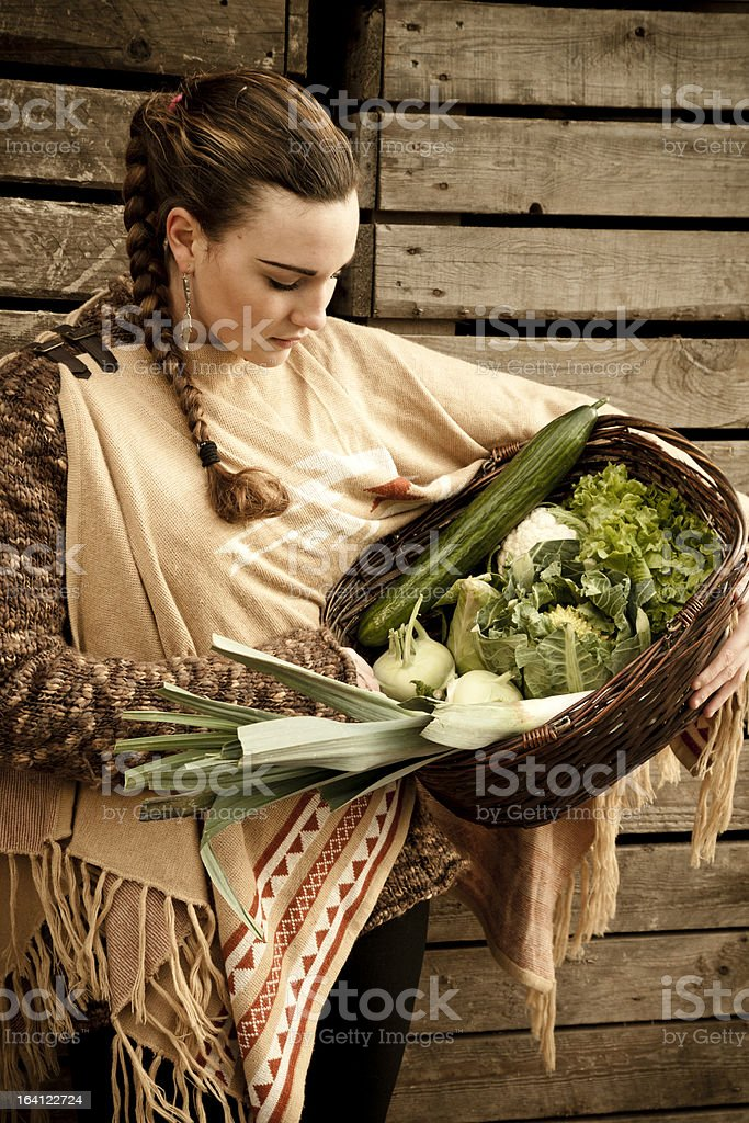 Young woman carrying home vegetables. royalty-free stock photo