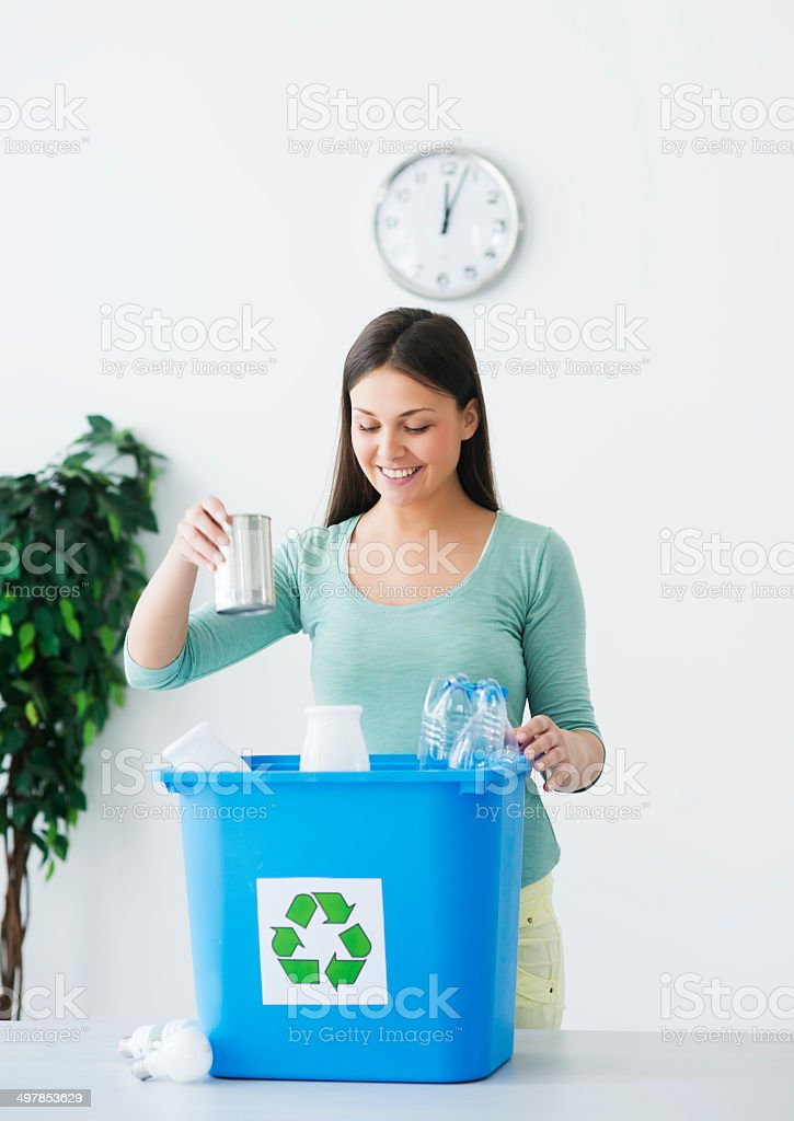 Young woman Carrying Recycling Bin royalty-free stock photo