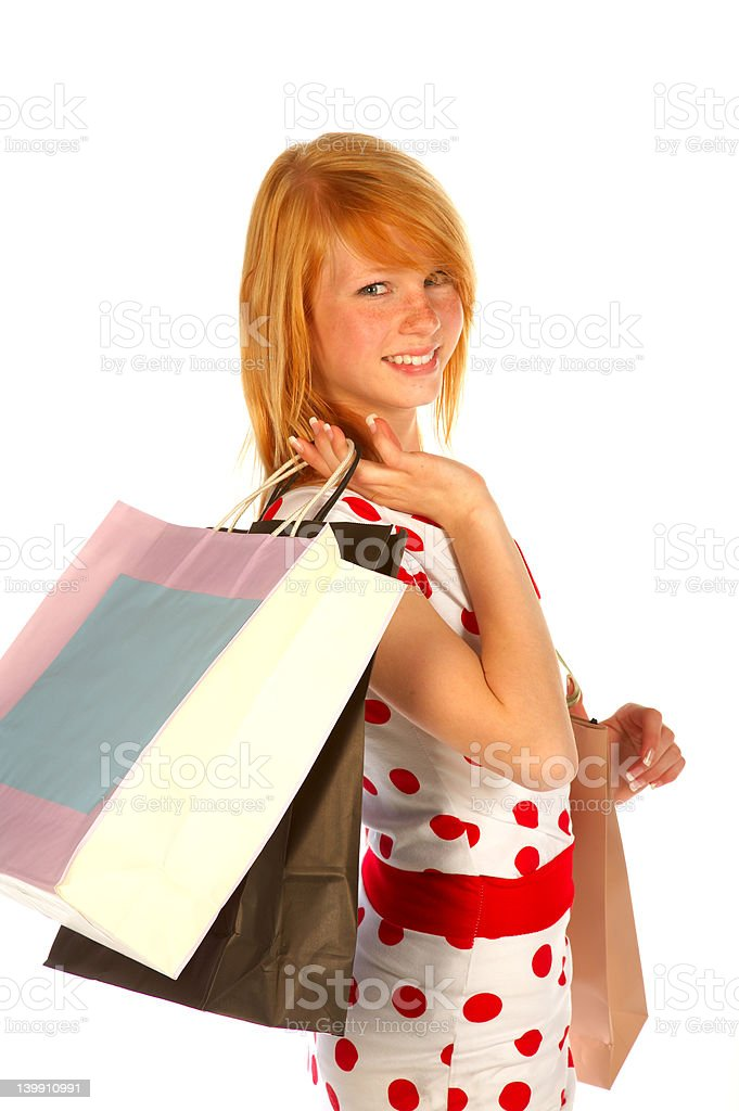 Young woman carrying shopping bags royalty-free stock photo
