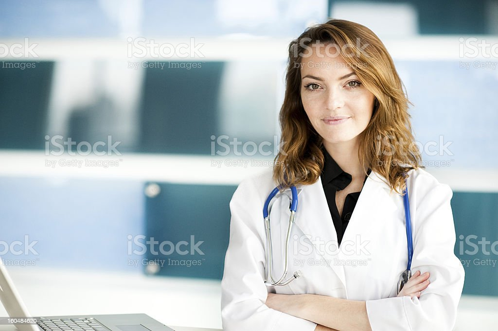 Young Woman Caucasian Doctor Nurse in Healthcare Office Clinic stock photo
