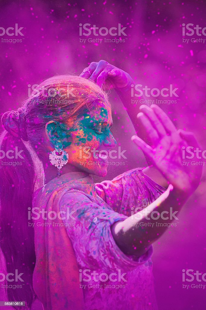 Young Woman Celebrating Holi Festival stock photo