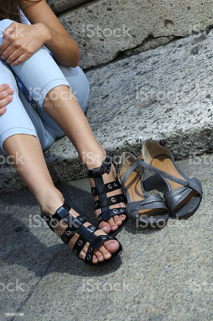 Young Woman Changing Sandals royalty-free stock photo