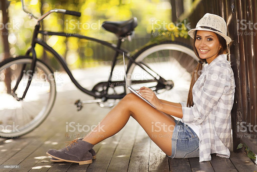 young woman checking her emails outdoors stock photo