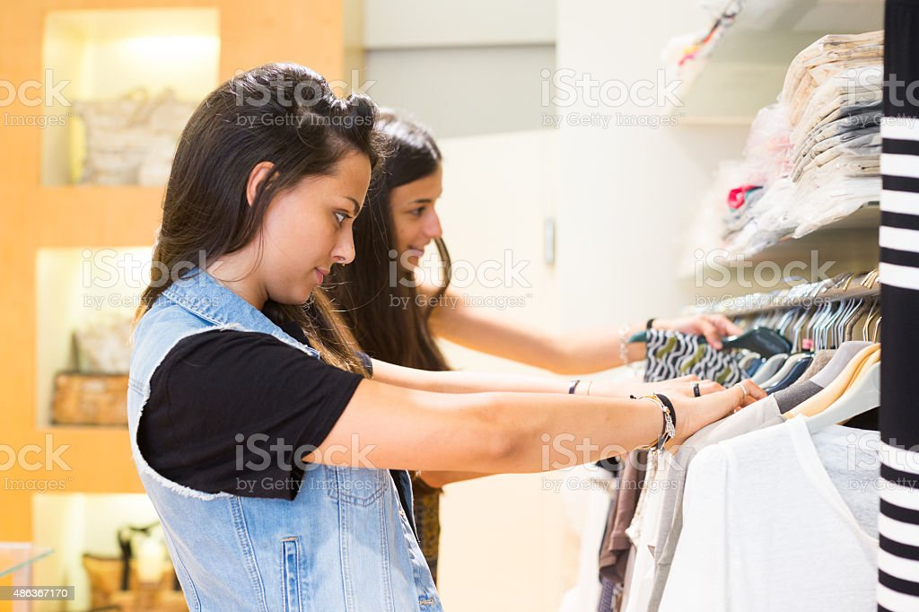 Young woman checking new clothes stock photo