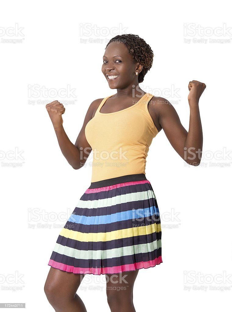Young woman cheering, arms up, portrait royalty-free stock photo
