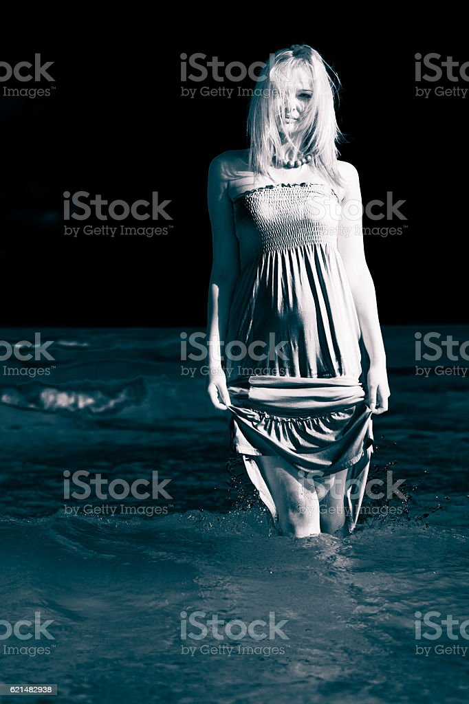 Young woman chilling out on the beach. stock photo