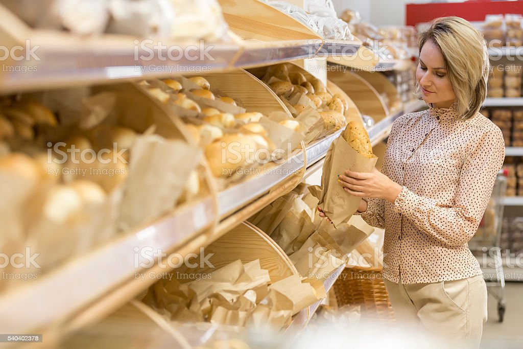Young woman choosing bakery products stock photo