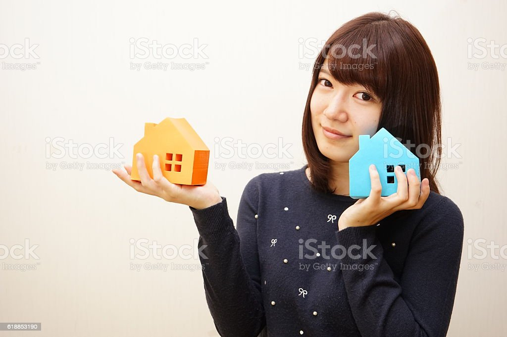 Young woman choosing home and real estate stock photo