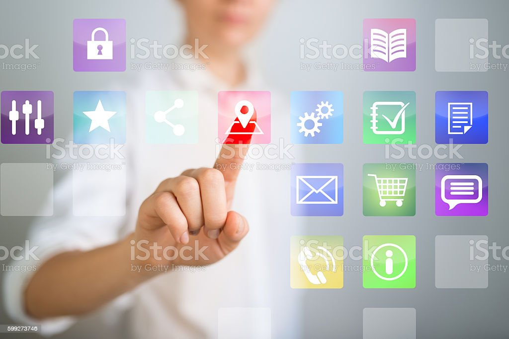 Young woman choosing information on touch screen stock photo