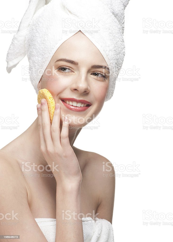Young woman cleaning her face royalty-free stock photo